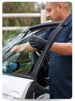 Man installing car window